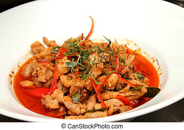 pork red curry in a white bowle