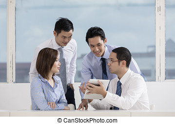 Business team working together - A group of muliethnic...