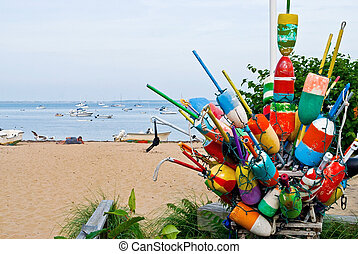 Bouys and Boats - Colorful buoys and a view of the sea on a...