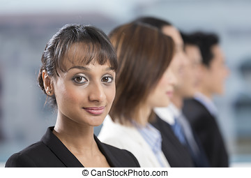 Indian Businesswoman leading a business team - A group of...