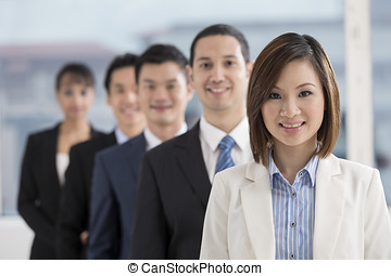 Asian Businesswoman leading a business team - A group of...