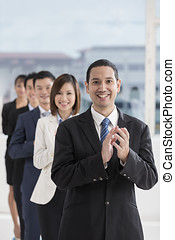 Happy Asian Business team - A team of business people...