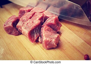 Raw beef meat on cutting board
