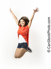 Happy woman jumping in air. - Happy Asian woman jumping for...