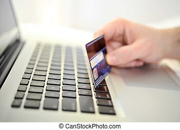 Man holding credit card in hand online shopping and banking