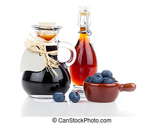 blueberry syrup in glass bottle or mixture, with heart label...