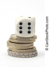 Dice and coins - Dice on stack of coins,close up,over white