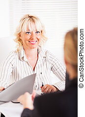 Business Agreement - Friendly business women conducting deal...