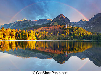 Mountain lake landscape with rainbow - Slovakia, Strbske...