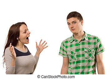 Excited young woman gesturing at her boyfriend as she tells...
