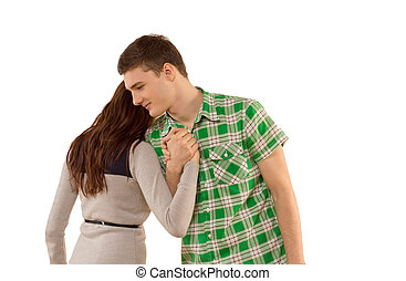 Young woman being comforted by her boyfriend as he clasps...