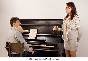 Young couple practicing a classical duet