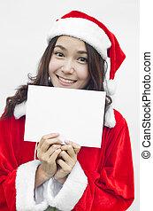 Girl in Santa holding banner.