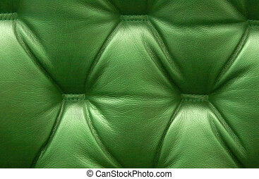 Green leather upholstery as a background.