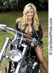 Girl On A Motorcycle - A beautiful young woman in a bikini...