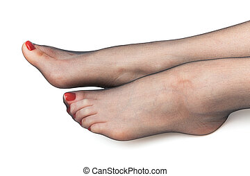 female feet in stockings on a white background
