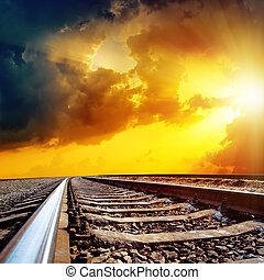 cloudy sunset over railroad