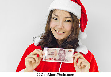 christmas woman wearing santa hat and holding money -...