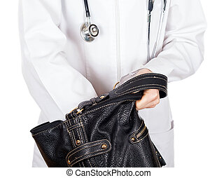 Searching - Young doctor looking for credit card in her bag