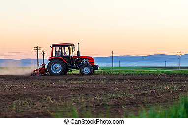 Agricultural work a tractor ploughing the field