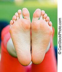 Foot care - Closeup photo of young woman bare feet