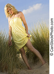 Sexy Innocence - A beautiful blond model walking through...