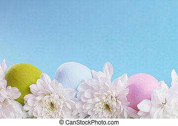 Easter card with eggs and flowers and copy space