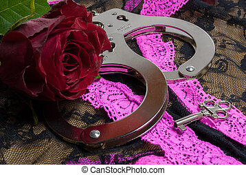 Handcuffs - a pair of handcuffs with a red rose for the lady...