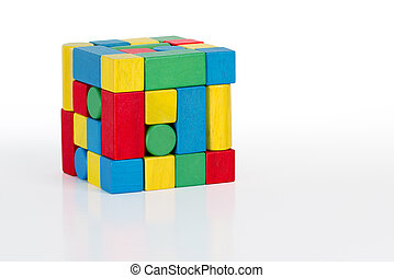 jigsaw puzzle cube toy, multicolor wooden pieces, colorful game bricks over white background