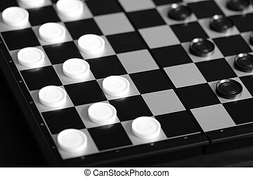 Checkers board game selective focus monochrome photo