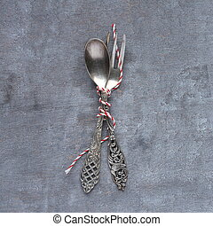 Old spoon and fork on gray wooden background