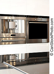 Oven - Silver oven and coffee machine in kitchen