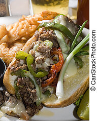 philly cheese steak sandwich with green red peppers pickle...