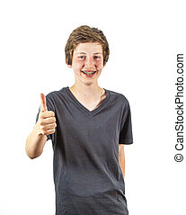 boy with retainer smiles and gives thumbs up sign - teenage...