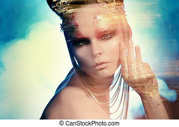 diffuse - Art project: beautiful woman with golden make-up...