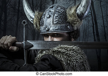 Defense, Viking warrior, male dressed in Barbarian style...