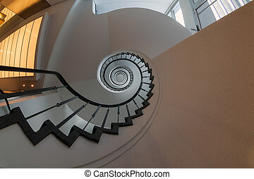 Spiral staircase. - View up a dramatic double spiral...
