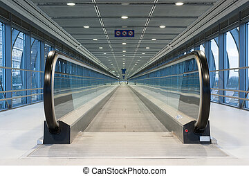 Moving sidewalk - A view along a long moving walkway or...