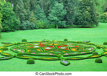 Beautiful chateau garden with colorful flower ornaments