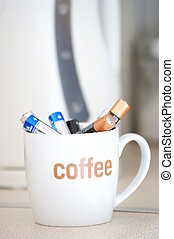 some get up and go - a coffee cup full of batteries