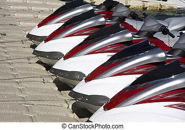 Group of Jet Skis on Dock for Fun