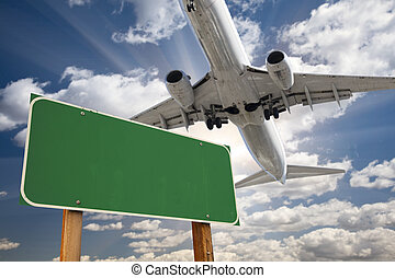 Blank Green Road Sign and Airplane Above with Dramatic Blue...