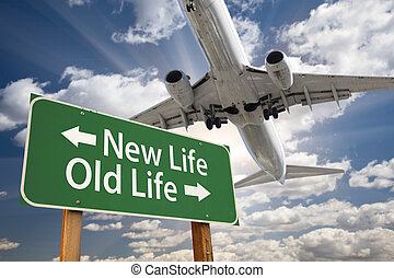 New Life, Old Life Green Road Sign and Airplane Above with...