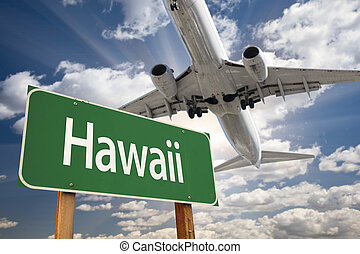 Hawaii Green Road Sign and Airplane Above with Dramatic Blue...