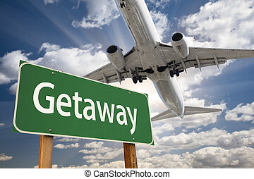 Getaway Green Road Sign and Airplane Above with Dramatic...