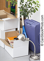 Packed boxes placed on the grey floor and ready to moving