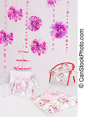Table with sweets for pink decoration party
