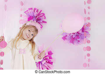 Little girl at pink decorated birthday party with balloon -...