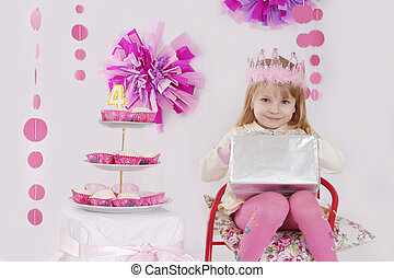 Girl with present at pink decoration birthday party