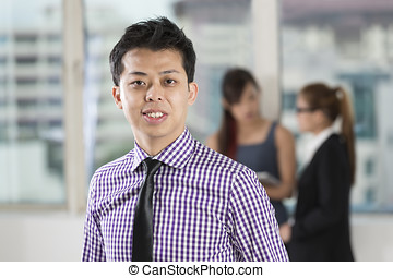 Asian business man standing in office